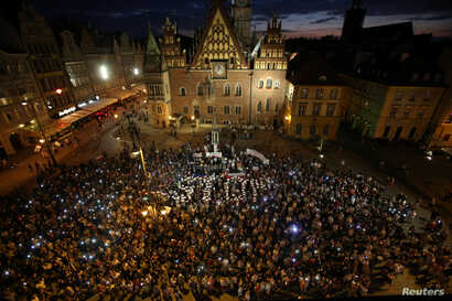 People attend a protest against judicial overhaul in Wroclaw, Poland, July 26, 2018.