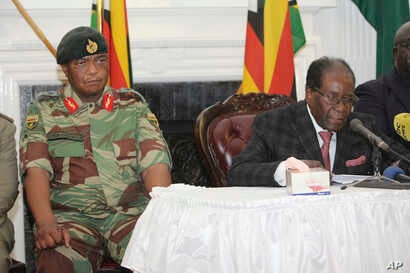 Zimbabwean President Robert Mugabe delivers his speech during a live broadcast at State House in Harare, Nov, 19, 2017.