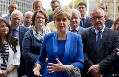 Nicola Sturgeon, First Minister of Scotland and the leader of the Scottish National Party talks to the media as she meets new SNP Members of Parliament in Parliament Square, Westminster, London, June 12, 2017.