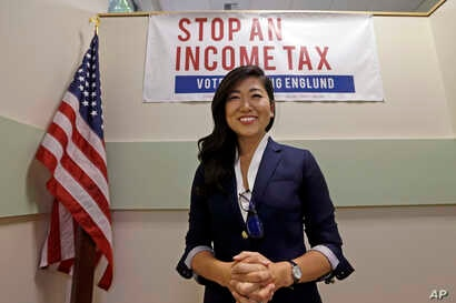 FILE - Jinyoung Englund, Republican candidate for 45th district Senate seat in Washington state, poses for a portrait at her campaign headquarters in Woodinville, Wash., Aug. 22, 2017.