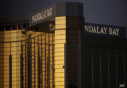 FILE - In this Oct. 3, 2017, file photo, windows are broken at the Mandalay Bay resort and casino in Las Vegas, the room from where Stephen Craig Paddock fired on a nearby music festival, killing 58 and injuring hundreds on Oct. 1.