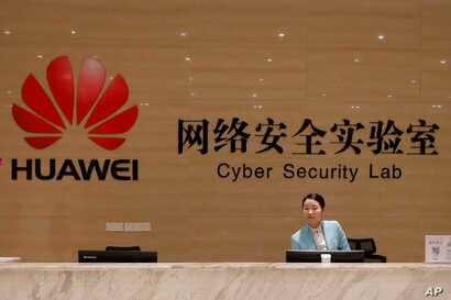 A receptionist stands at the front counter of the Huawei's Cyber Security Lab at the Huawei factory in Dongguan, China's Guangdong province, March 6, 2019. Huawei Technologies Co. is one of the world's biggest supplier of telecommunications equipment