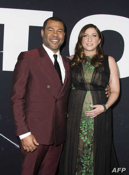 "FILE - Director Jordan Peele and actress Chelsea Peretti attend the Universal Pictures special screening of ""Get Out"" in Los Angeles, Feb. 10, 2017."