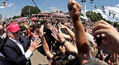 Republican presidential candidate Donald Trump greats the crowd at the Iowa State Fair in Des Moines, Aug. 15, 2015.