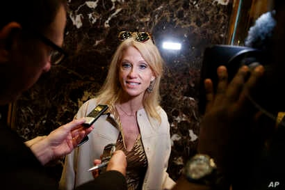 Kellyanne Conway, campaign manager for President-elect Donald Trump, talks with reporters as she arrives at Trump Tower, Nov. 14, 2016, in New York.