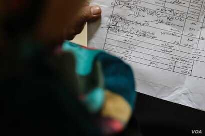 Reja holds the paperwork that proves she has legitimately registered the marriage.  She had to register the marriage in order to get a divorce that allowed her to claim child support.