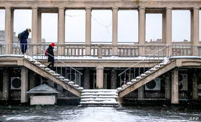 """A view of the 1938 Rodina (""""Motherland"""") cinema, a Stalinist landmark in northern Moscow with huge pillars decorated with Soviet mosaics, Dec. 13, 2018."""