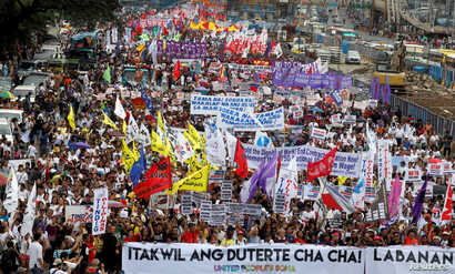 Activists display banners and placards as they march near the House of Representatives to protest President Rodrigo Duterte's State of the Nation address in Quezon city, Metro Manila, in Philippines, July 23, 2018.