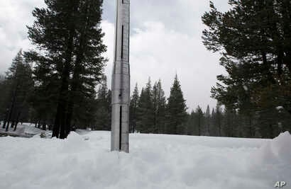 The snow survey tube sits in the snow placed there by Frank Gehrke, chief of the California Cooperative Snow Surveys Program for the Department of Water Resources, after conducting the manual snow survey at Phillips Station, March 30, 2017, near Echo...