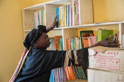The school library is being stocked. Rebecca hopes the books will help heal the students' troubled minds.