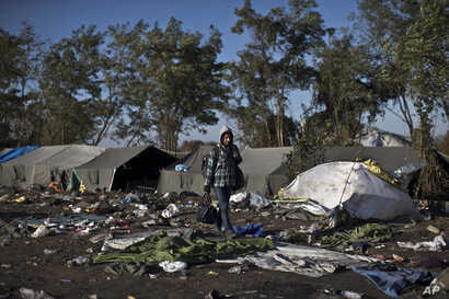 A youth walks towards Serbia's border with Croatia, in Berkasovo, Serbia, Oct. 25, 2015. Thousands of migrants and refugees are still crossing from Serbia into Croatia and continuing their journey towards Western Europe.