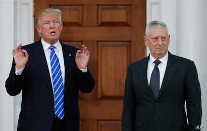 FILE -  President-elect Donald Trump stands with retired Marine Corps Gen. James Mattis at Trump National Golf Club Bedminster clubhouse in Bedminster, N.J., Nov. 19, 2016.
