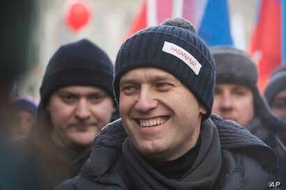 Russian opposition leader Alexei Navalny, attends a rally in memory of opposition leader Boris Nemtsov, in Moscow, Feb. 25, 2018. Thousands of Russians took to the streets of Moscow to mark three years since Nemtsov was gunned down outside the Kremli...