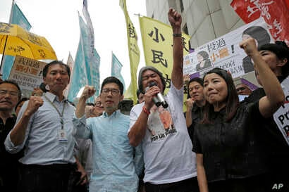 Pro-democracy Hong Kong lawmakers of the legislature council, Edward Yiu, Nathan Law, Leung Kwok-hung and Lau Siu-lai protest outside the High Court in Hong Kong, July 14, 2017.