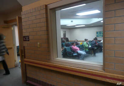 People sit in the waiting room of the Indian Health Service clinic in Crow Agency, Mont., Oct. 16, 2008.  The Indian Health Service system serves almost 2 million American Indians in 36 states.