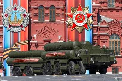 FILE - Russian S-400 air defense missile systems are on display during a rehearsal for the Victory Day military parade in Red Square in Moscow, Russia, May 7, 2017.