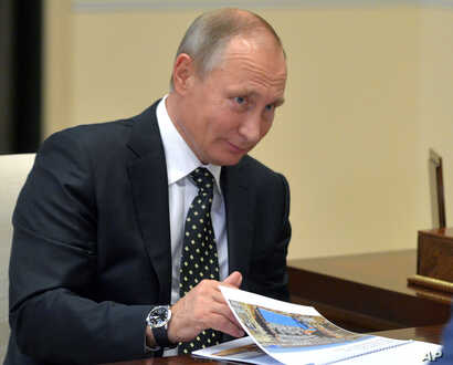 """Russian President Vladimir Putin telephoned congratulations to U.S. President-elect Donald Trump Monday and said Russia is ready for a """"partner-like dialogue"""" with the United States."""