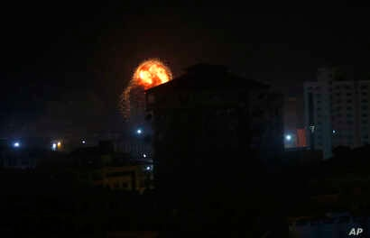 An explosion caused by Israeli airstrikes is seen on Gaza City, March 15, 2019.