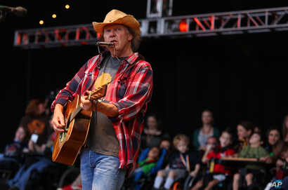 Neil Young performs at the Bridge School Benefit Concert at the Shoreline Amphitheatre, Oct. 20, 2012, in Mountain View, Calif.