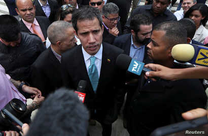 Venezuelan opposition leader JuanGuaido, who many nations have recognized as the country's rightful interim ruler, speaks to the media after a meeting with young leaders at the National AssemblyinCaracas, Venezuela, April 4, 2019.