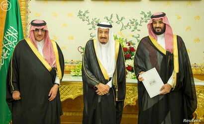 (L-R) Saudi Crown Prince Mohammed bin Nayef, Saudi King Salman, and Saudi Arabia's Deputy Crown Prince Mohammed bin Salman stand together as Saudi Arabia's cabinet agrees to implement a broad reform plan known as Vision 2030 in Riyadh, April 25, 2016...