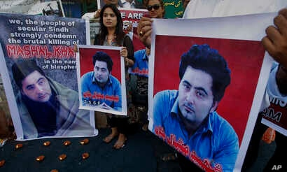 FILE - Members of a Pakistani civil society demonstrate April 22, 2017, in Karachi, Pakistan, against the killing of Mashal Khan, a student at the Abdul Wali Khan University in the northwestern city of Mardan. Police say the lynching of Khan, falsely...