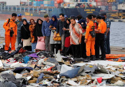 Families of passengers of  Lion Air flight JT610 stand as they look at the belongings of the passengers at Tanjung Priok port in Jakarta, Indonesia, October 31, 2018.