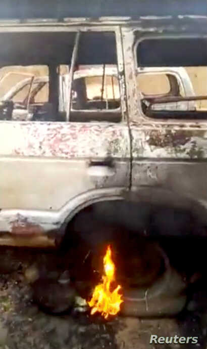 A burning vehicle is seen in a village after an attack Ogossagou, Mali, in this still image obtained from a social media video on March 24, 2019.
