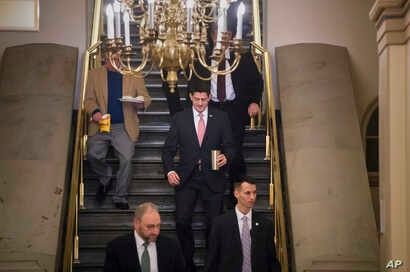 Speaker of the House Paul Ryan, R-Wisconsin, arrives for a meeting of fellow Republicans on the first morning of a government shutdown after a divided Senate rejected a funding measure, at the Capitol in Washington, Jan. 20, 2018.