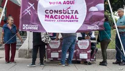 People vote on whether to continue with the $13 billion airport to replace the current Benito Juarez International Airport, in Mexico City, Oct. 28, 2018.