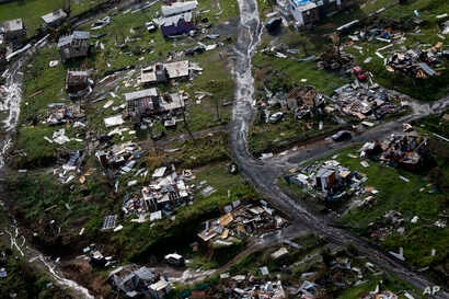FILE - Destroyed communities are seen in the aftermath of Hurricane Maria in Toa Alta, Puerto Rico, Sept. 28, 2017.