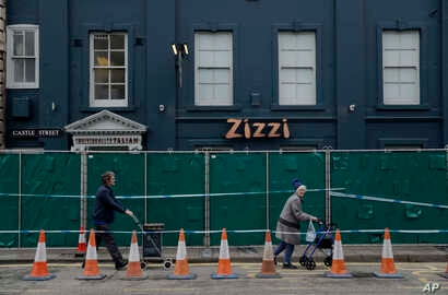 A police cordon and fence are placed outside a Zizzi restaurant near the area where former Russian double agent Sergei Skripal and his daughter were found critically ill following exposure to the Russian-developed nerve agent Novichok in Salisbury, E...