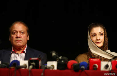 Ousted Pakistani prime minister Nawaz Sharif appears with his daughter Maryam at a news conference at a hotel in London, Britain, July 11, 2018. They are expected to return ot Pakistan Friday.
