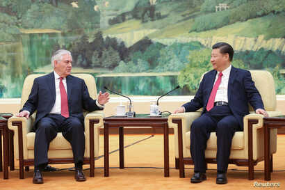 Chinese President Xi Jinping (R) shakes hands with U.S. Secretary of State Rex Tillerson before their meeting at at the Great Hall of the People on March 19, 2017 in Beijing, China.