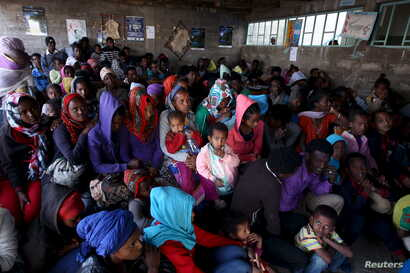 FILE - Eritrean refugees wait to get registered on arrival at the Indabaguna refugee reception and screening center in Tigrai region near the Eritrean border in Ethiopia, Feb. 9, 2016.