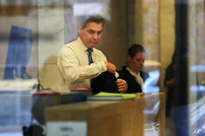 CNN's Jim Acosta goes through security as he enters the federal court building in Washington, Nov. 14, 2018.