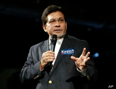 Former U.S. Attorney General Alberto Gonzales introduces Republican presidential candidate Ohio Gov. John Kasich at a rally,  Feb. 27, 2016, in Nashville, Tennessee.