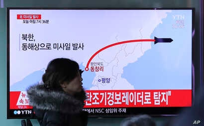 A television screen showing a news program reporting about North Korea's missile firing, at Seoul Train Station in Seoul, South Korea, Monday, March 6, 2017.