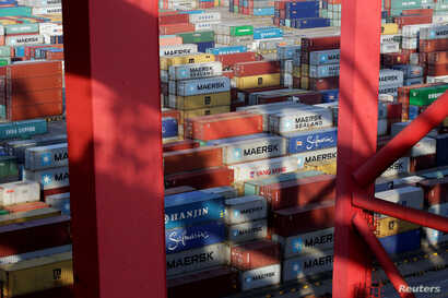 Containers are seen at the Yangshan Deep Water Port, part of the Shanghai Free Trade Zone, in Shanghai, China, Sept. 24, 2016.