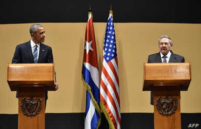 U.S. President Barack Obama, left, and Cuban President Raul Castro hold a joint press conference after meeting at the Revolution Palace in Havana, March 21, 2016.