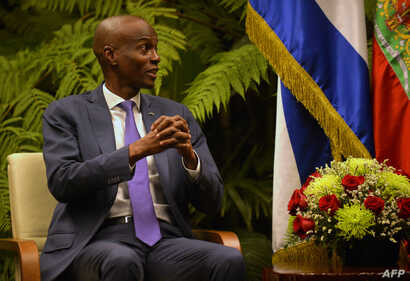 Haiti's President Jovenel Moise gestures during a meeting with Cuban President Miguel Diaz-Canel (not shown) at Revolution Palace in Havana, Dec. 3, 2018.