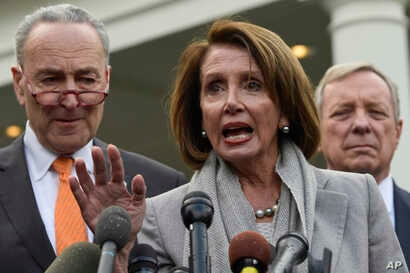 House Speaker Nancy Pelosi, center, speaks as she stands next to Senate Minority Leader Sen. Chuck Schumer, left, and Sen. Dick Durbin right, following their meeting with President Donald Trump at the White House in Washington, Jan. 9, 2019.