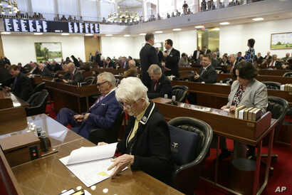 Rep. Julia Craven Howard, R-Davie, foreground, and other North Carolina lawmakers gather for a special session Wednesday, March 23, 2016.