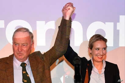 AfD top candidates Alexander Gauland, left, and Alice Weidel celebrate with their supporters during the election party of the nationalist 'Alternative for Germany', AfD, in Berlin, Sept. 24, 2017, after the polling stations for the German parliament ...