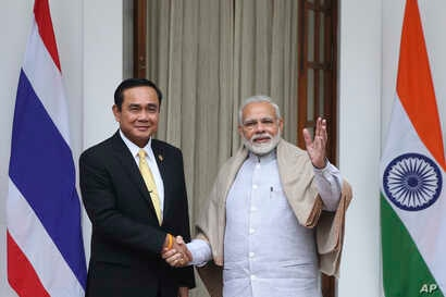 Thailand's Prime Minister Prayuth Chan-ocha, left, and Indian Prime Minister Narendra Modi pose for the media ahead of their meeting in New Delhi, India, Jan. 25, 2018.