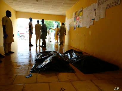 FILE - Family members wait to claim bodies of suicide attack victims at a hospital in Konduga outside Maiduguri, Nigeria, Aug. 16, 2017. The attack was blamed on Boko Haram militants.