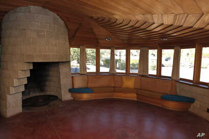 FILE - The master bedroom is seen in this home designed by noted architect Frank Lloyd Wright, in Phoenix, Oct. 19, 2012.
