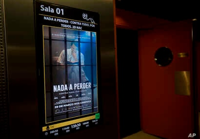 """A poster promotes the film """"Nada a Perder,"""" or """"Nothing to Lose,""""  in a theater in Rio de Janeiro, May 11, 2018. The film, a biopic about the man who founded one of Brazil's largest evangelical churches, has sold more tickets than any other film in r..."""