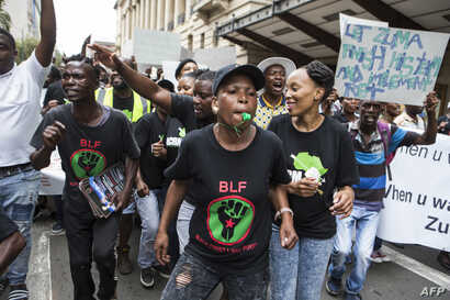 Supporters of the Black First Land First (BLF) movement march to Luthuli House, the South African ruling Party African National Congress (ANC) headquarters, to show their support for the South African president in Johannesburg, Feb. 5, 2018.