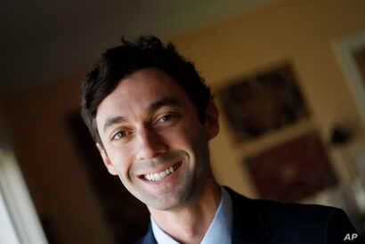 FILE - Democratic candidate for Georgia's 6th congressional district Jon Ossoff poses for a portrait in Atlanta, Feb. 10, 2017.